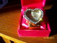 THIS IS A HEART SHAPED DIAMOND STUDDED GOLD WATCH WITH
