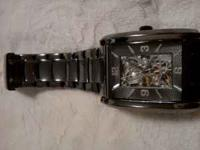 I have a very nice mens Folio all stainless steel watch