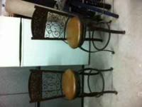 For sale 2 brown metal counter stools with brown
