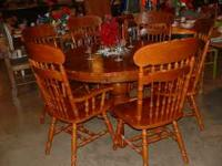 Just in a very nice round oak table with 6 chairs