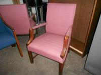 These are high back chairs in a dusty rose fabric with