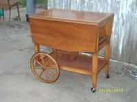 Very nice tea cart. $75.00 This opens into a small