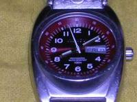 WATCH IS DESIGNER!!!!cost $295.00 New!!!!Sell
