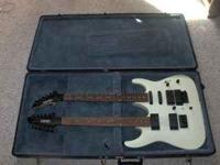 Vestor 2 neck guitar. 6 string has whammy bar and