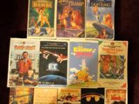 Assortment of VHS video tapes including Walt Disneys
