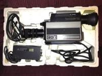 Hitachi VHS color video camera. Attaches to a VCR for