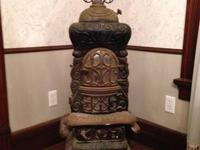 "This Abram Cox Stove Co. coal stove is 53"" high and 19"""