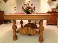 Antique Dining Table features Victorian style carved