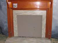 This authentic simple vintage fireplace mantle is from