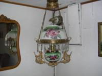 Beautiful antique hanging lamp. It has been converted