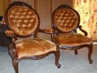 A pair of Victorian reproduction Mr. & Mrs. Chairs.