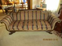 Classic style sofa with claw feet and carved details