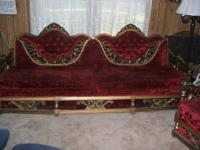 Crushed red velvet victorian style couch and chair.