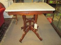 This is a beautiful Victorian marble top parlor table.