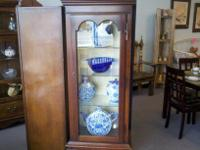 Vintage lighted Victorian style curio cabinet. Really