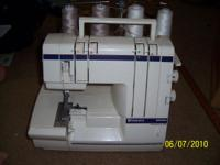 VIKING HUSKYLOCK SERGER BOUGHT FOR $800.00 HOLDS 4