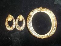 This is a beautiful vintage Diane Von Furstenberg gold