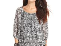 This charming lace-printed peasant top from Vince