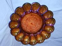 I have for sale an Indiana Glass iridescent hobnail
