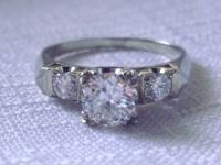 Vintage Engagement Ring. The Ring has 3 Round Brilliant