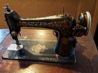This is a Singer Model 66 sewing machine manufactured