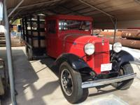 Vintage 1934 Ford Model BB Truck with side boards. In