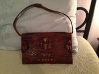 This purse was purchased by my mother in 1940 and only