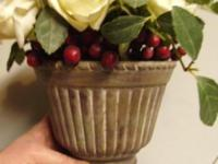 Classic 1950's red berries and phony roses centerpiece