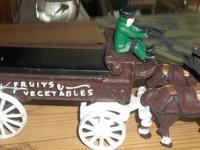 Cast Iron Horse drawn frsh fruits and vegatables wagon.