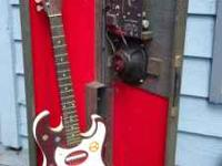 All original Sears Silvertone - redburst with amp in