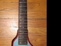 This is a vintage 1980's Hondo Alien Electric Bass