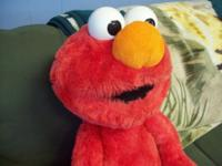 I have a lovable Sesame Road Elmo Plush, generated by