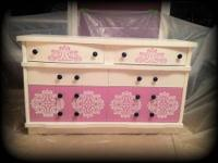 I've just refinished this vintage dresser with feminine