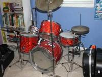 Red vintage Apollo Drum Set. Fairly new heads. Includes