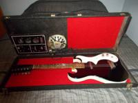 For sale is a Sears Silvertone Guitar with integrateded