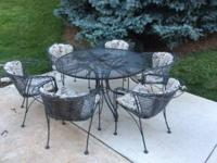 For sale ... a vintage 7 piece wrought iron outdoor