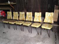 Up for sale is a set of 6 yellow vintage chairs and