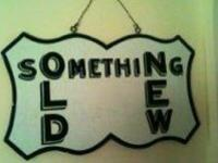 Vintage sign says 'something new something old'. I