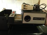 This Airequipt 4200 electronic focus slide projector is