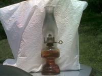 i have one old oil lamp amber glass still has oil in it