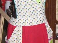 These 1950's and 1960's style aprons are cute!  They