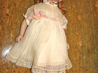 We are offering an antique Aranbee Doll. She has some