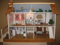 For Sale is an adorable assembled doll house with