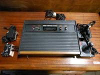 VINTAGE ATARI 2600 GAME CONSOLE WITH 2 CONTROLLERS AND