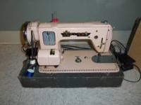 Vintage Sewing machine with case made by ATLAS. Works!!
