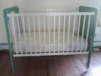 Classic Child Crib, its white and green, plexiglass in