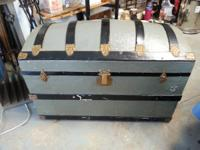 This is a beautiful vintage barrel top trunk with
