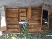 All pieces are made from real wood. The dresser has 9