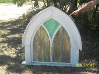 Beautiful slag glass church windows with colors of