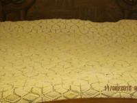 Beautiful vintage crochet bedspread. Shown on a